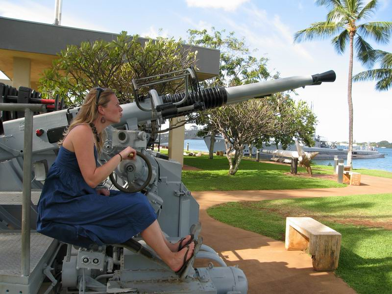 Amie checking out anti-aircraft artillery at Pearl Harbor