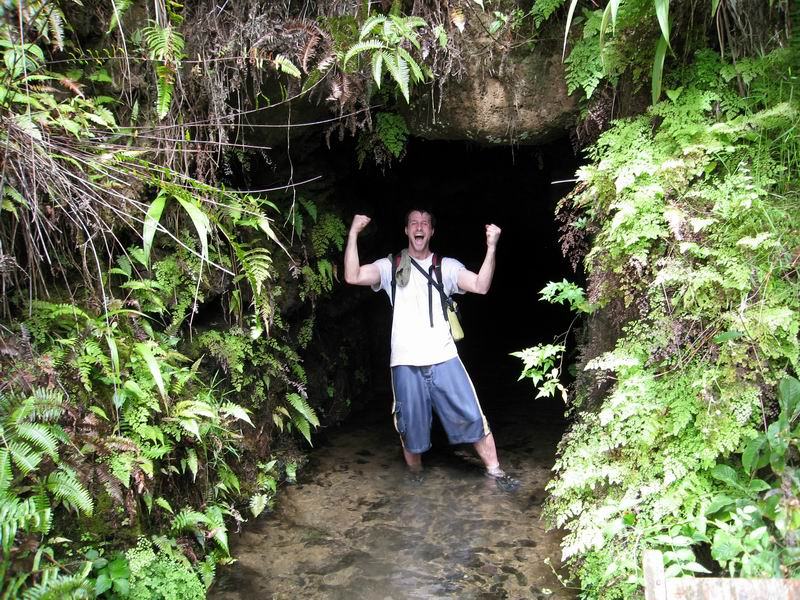 Steve celebrating finding abandoned irrigation tunnels deep in Kauai's jungle