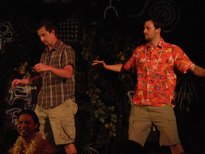 Ryan and Steve shaking their buns onstage at a luau