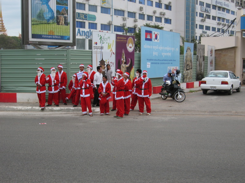 Christmas Day Classic.  How many Santas can you fit on a Phnom Penh street corner?