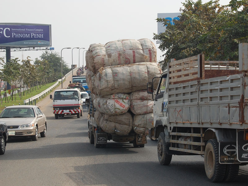 Heavy load - a truck doubles in size with all the rice sacks it's carrying.