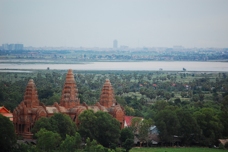 Phnom Baset view of temple with Phnom Penh in the far distance