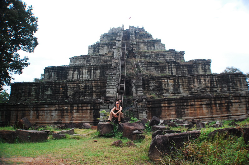 Amie below the mighty Prasat Thom at Koh Ker