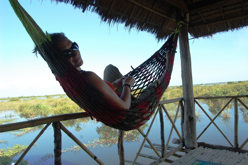 Relaxing on a stilt platform on the way to the floating villages south of Siem Reap