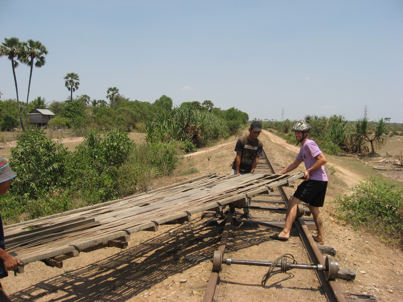 Carrying bamboo train from buddy's house to the tracks