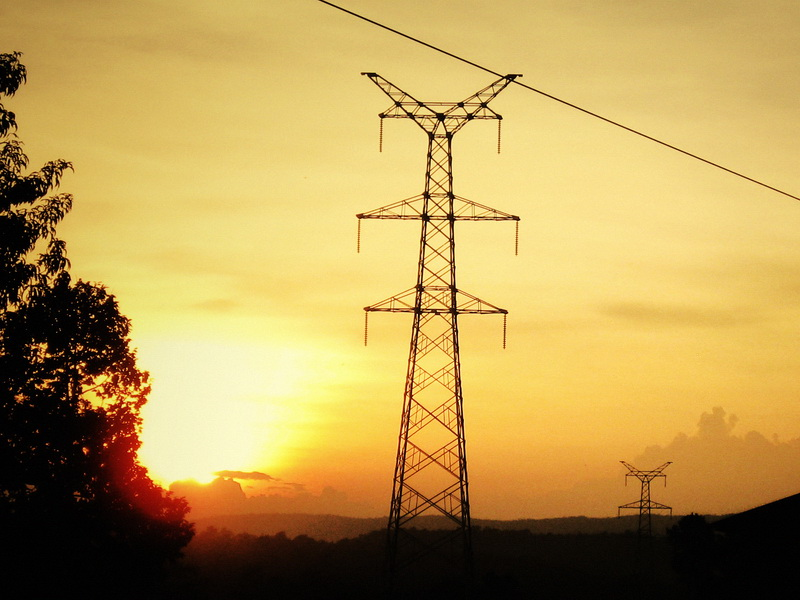 Following the electricity pylon towers past sunset