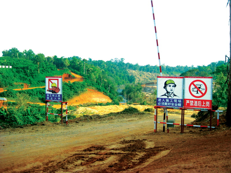 Signs around the Steng Atay hydropower dam work site