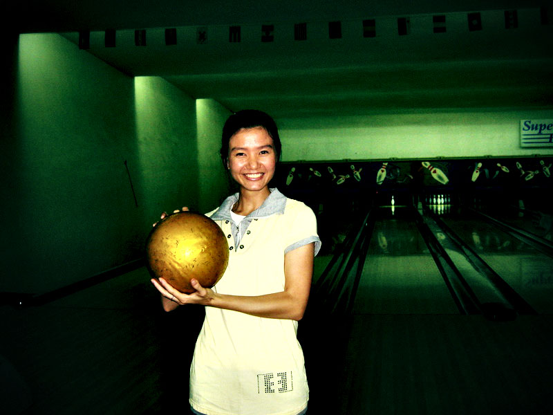 Tiny girl, massive bowling ball.