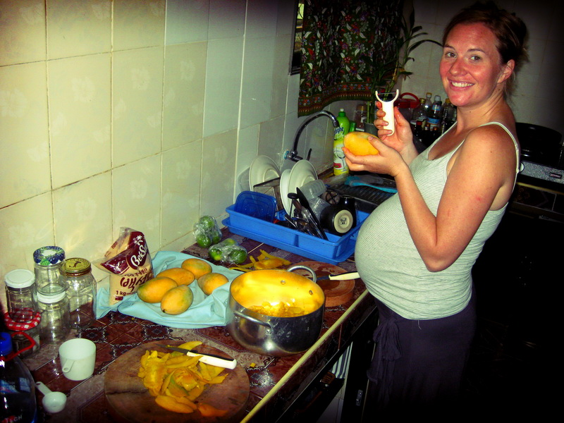 Cutting up mangoes from our tree to make mango jam!