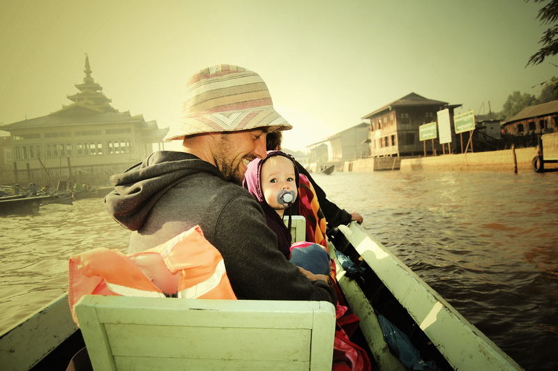 Steve + Aya boating across Inle Lake