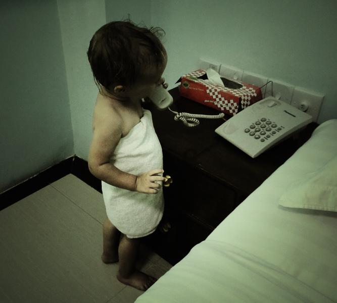Aya answering the phone in Mandalay