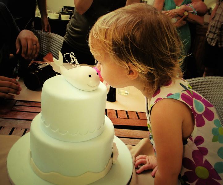 Aya kissing Jodi's whale cake