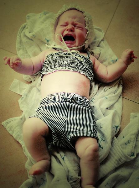 Arwen loving her new swimsuit