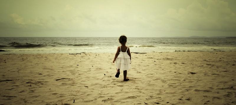 Toddler lone beach wanderer