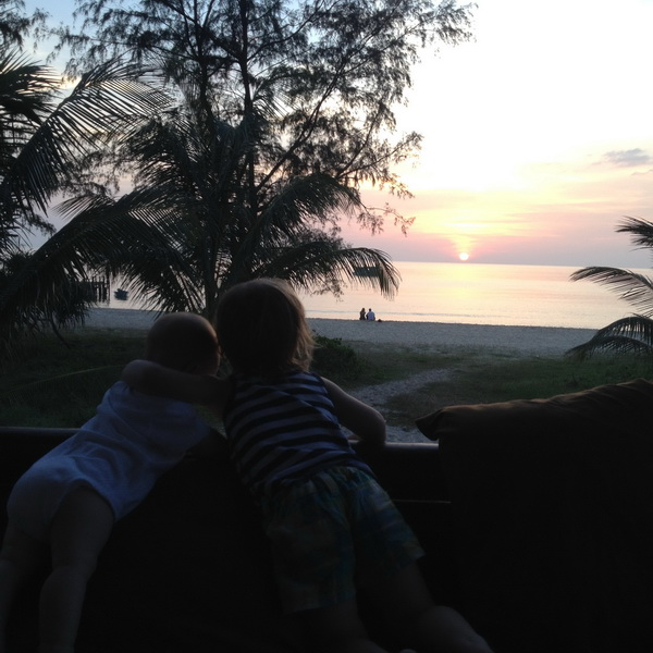 Sisters watching the sun go down
