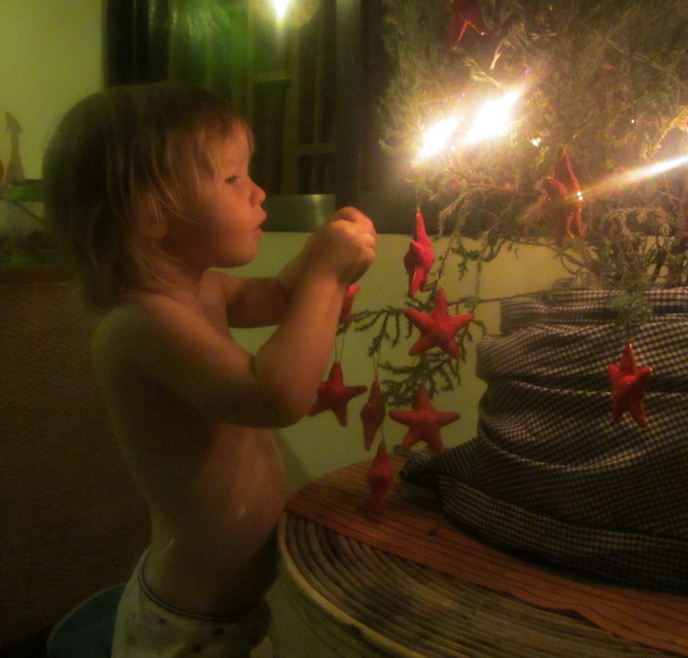 Aya putting stars on the christmas tree