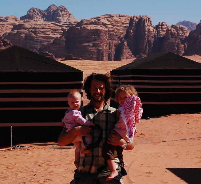 Steve + the kids at Sunrise camp in Wadi Rum