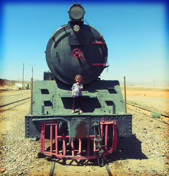 Aya riding the historical train at Wadi Rum station