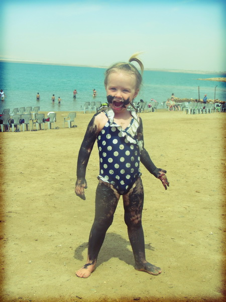 Aya getting into dead sea mud-bathing