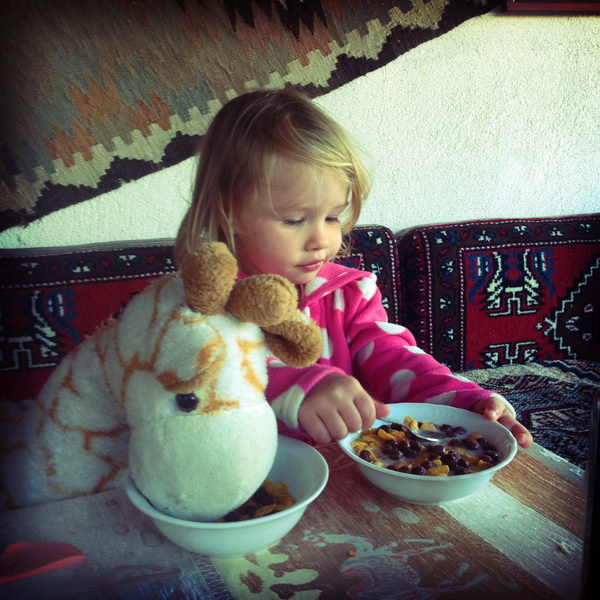 Aya and her giraffe friend eating breakfast