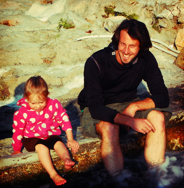 Aya + Steve warming their feet in a Hierapolis aqueduct