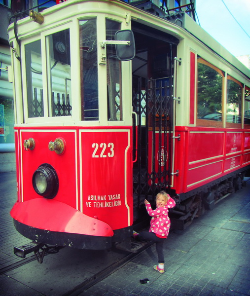 Aya exploring a parked tram car