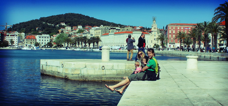 Family relaxing at the Split waterfront