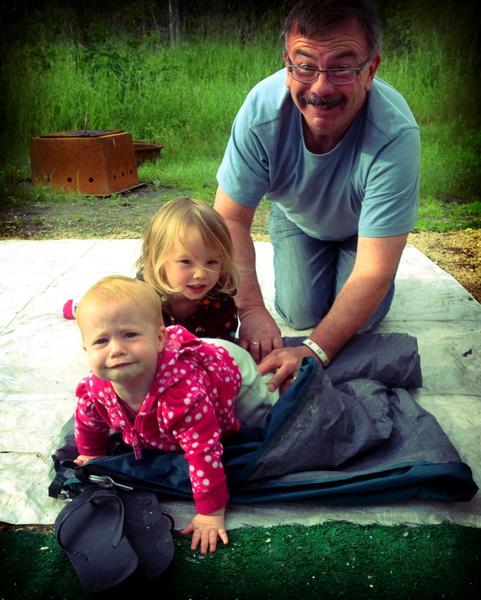 Aya + Arwen helping Hugh roll up the tent