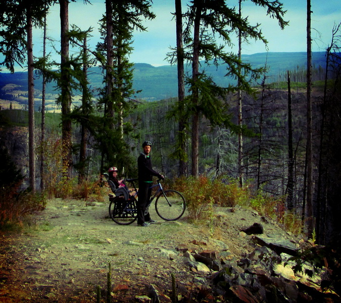 Steve + Aya biking through Myra Canyon Prov. Park