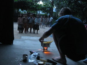 Village kids awestruck by camping stove (everyone uses wood/charcoal stoves)