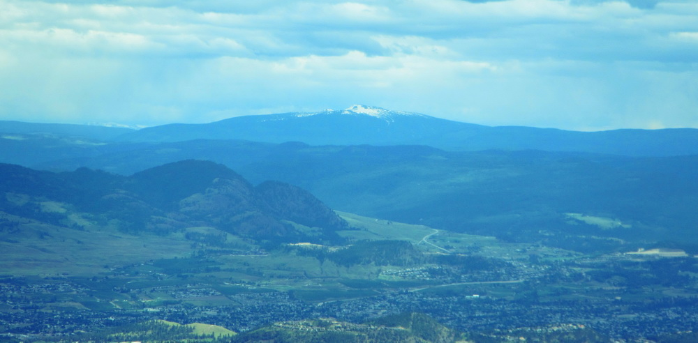 View of Big White and Black Knight Mountain behind Kelowna